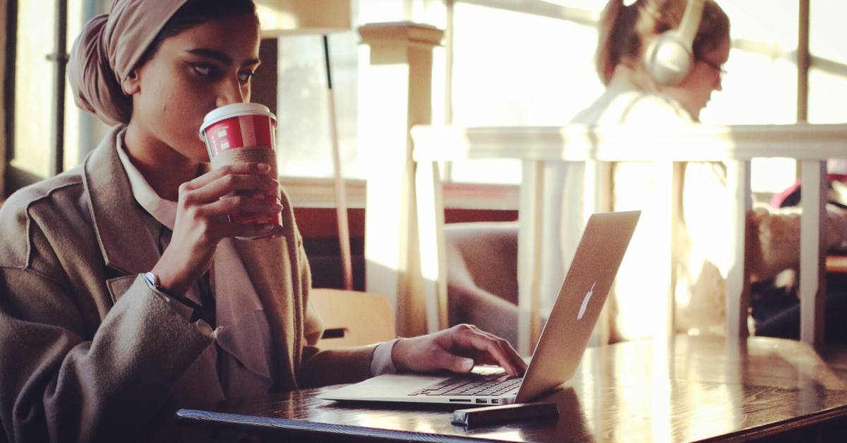 Girl with coffee and laptop in Recharge